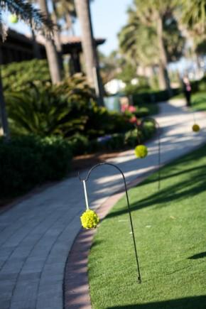 Green wedding flowers on walkway