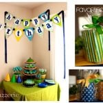 Blue, green, and yellow boy's 1st birthday party picture