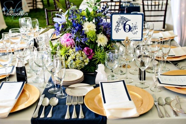 blue and gold wedding reception table setting picture