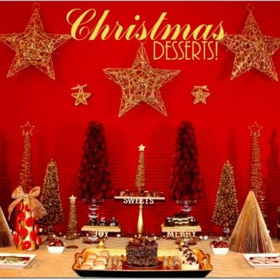 gold red christmas dessert table by pizzazzerie