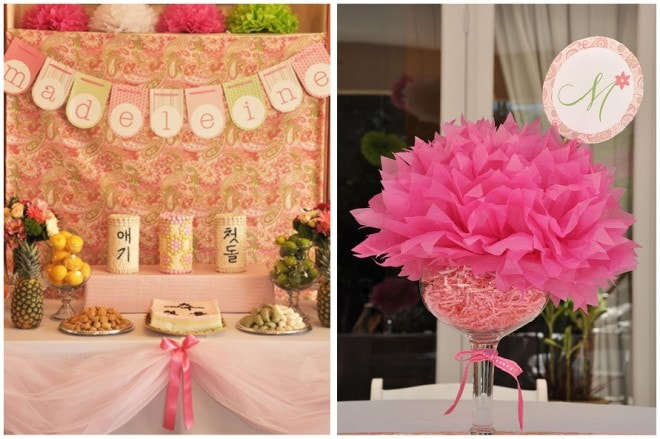 pink tissue paper pom pom party table