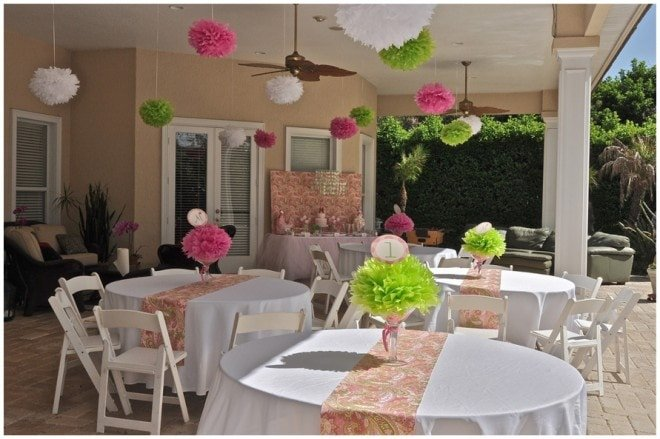 hanging tissue paper pom poms pink and green