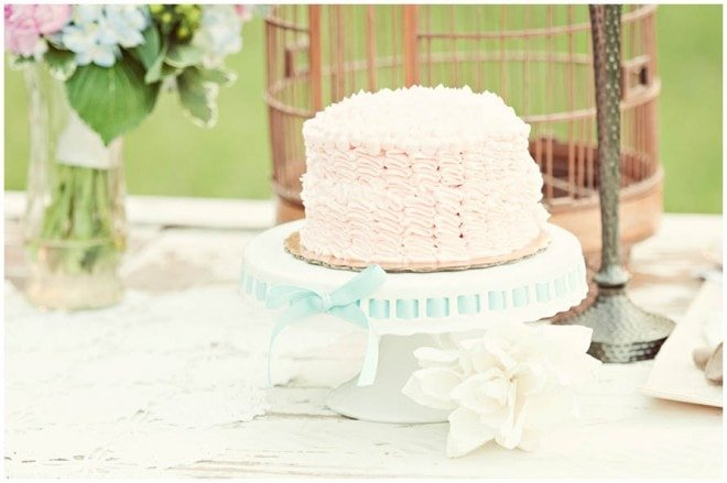 I absolutely LOVE this pink ruffled cake on a simple white cake stand