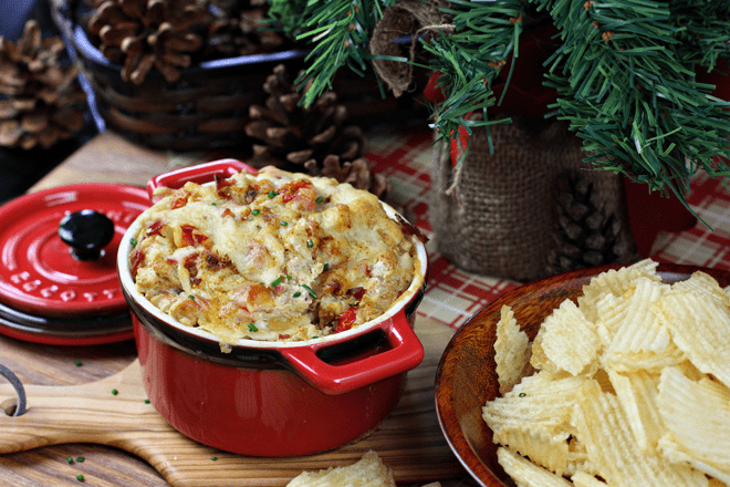Zesty Cajun Artichoke Dip paired with Ruffles potato chips #FritoLayHoliday