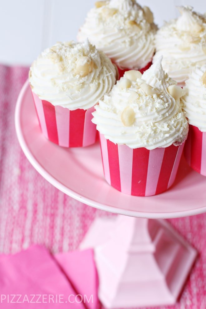 Did you know you can make frosting flavors with coffee creamers?! White Chocolate Macadamia Nut Cupcakes!