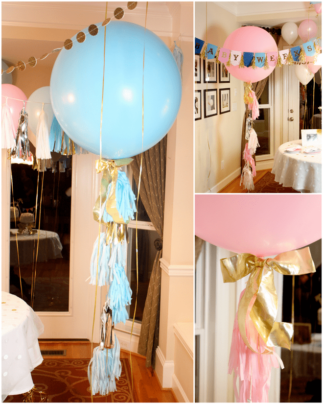 Big balloons with tassel garland for baby gender reveal!