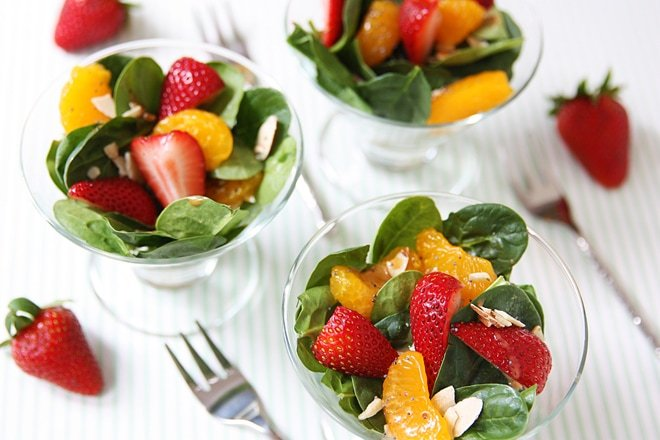 Strawberry Poppyseed Spinach Salad with the most AMAZING Raspberry Orange dressing!