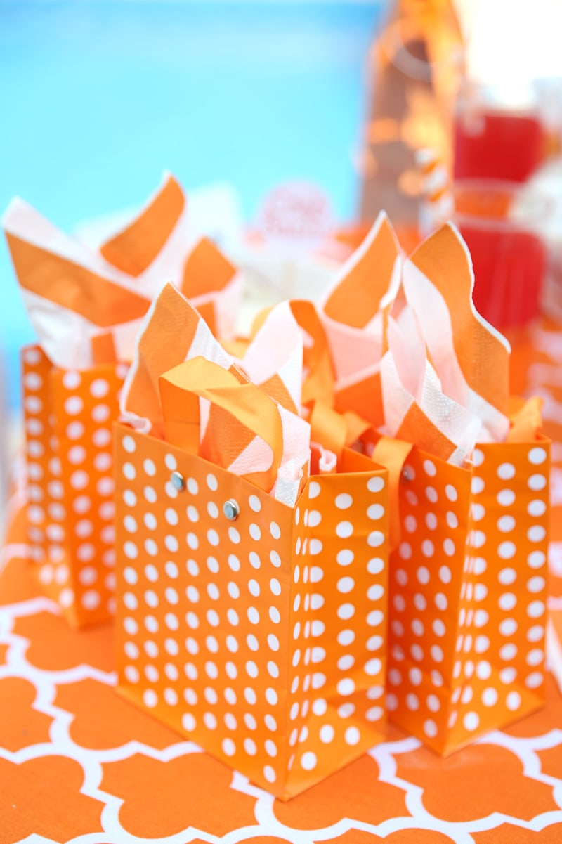 Orange and white polka dot gift bags for a party!