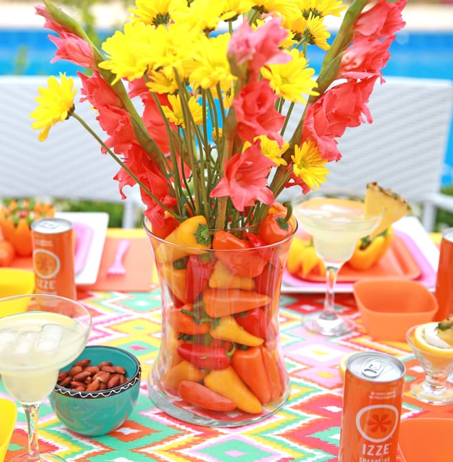 How to use mini peppers to create a fabulous vase for a fiesta night party! Pizzazzerie.com