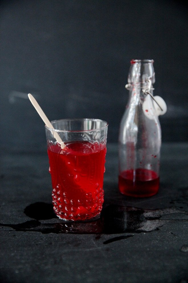 cinnamon simple syrup in a red halloween drink