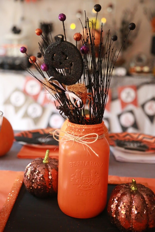 Cute spray painted glass jar for Halloween centerpiece