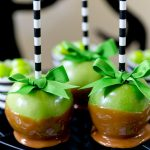 Cutest caramel apples ever! Perfect for color coordinating for Halloween and fall parties! Love black and white stripes!