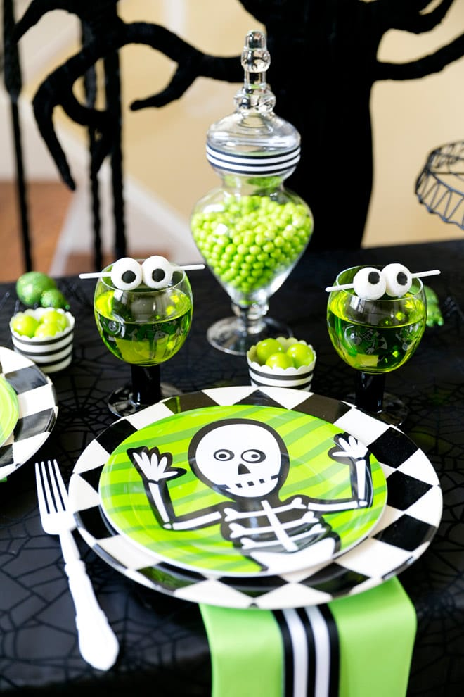 This Halloween party is too cute! Skeleton themed in green and black and full of cute treats and fun Halloween party ideas for the kids!