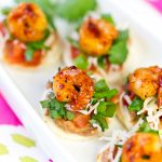 Easy + Delicious Shrimp Tostada Bites, perfect for a party! Pizzazzerie.com