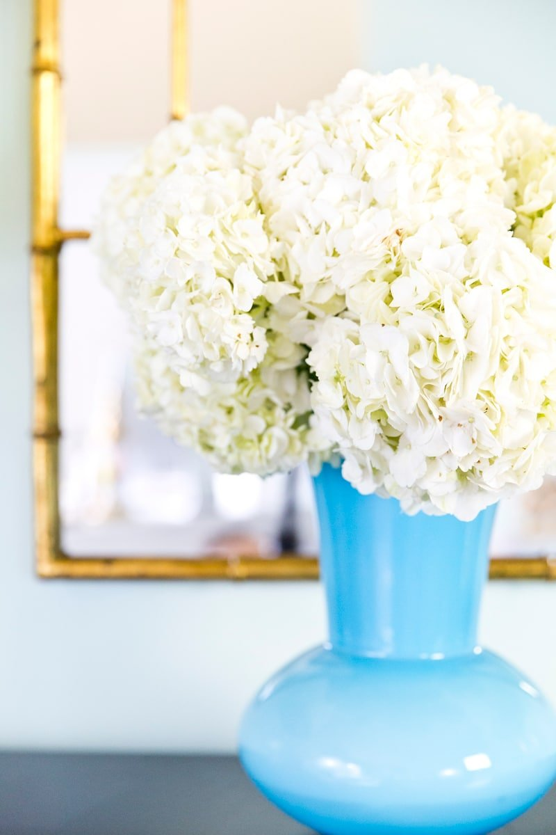 White hydrangeas in Blue Vase in Blog Office