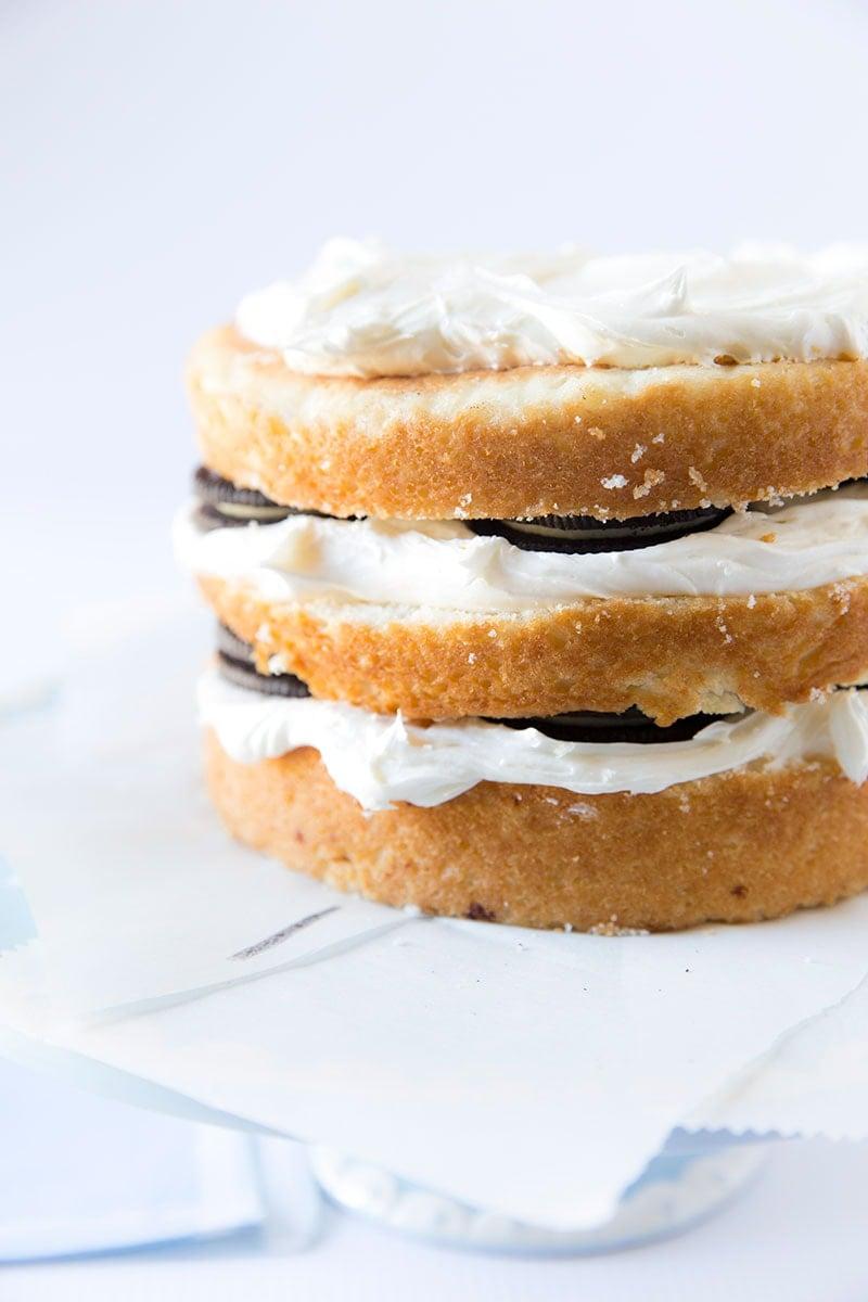 Oreos hidden inside a Vanilla Almond Snowball Cake! Pizzazzerie.com