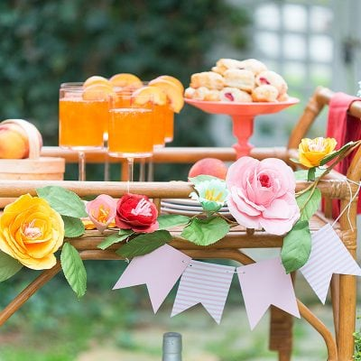 bar cart of cocktails and flowers for a party