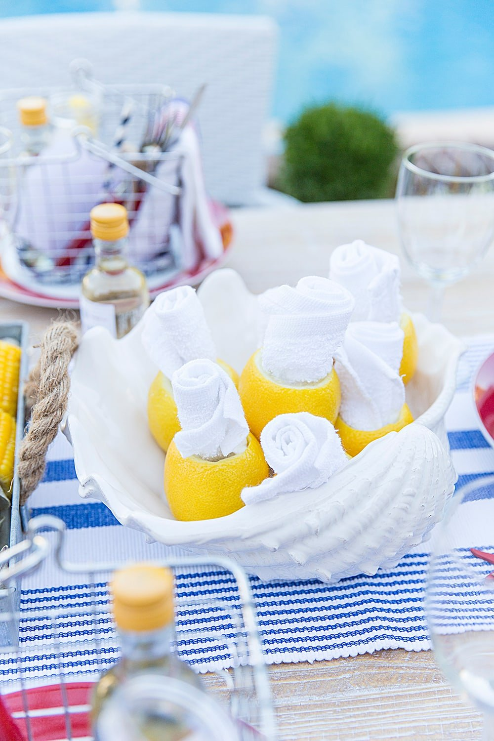 Rolled towels tucked in lemons, perfect for those messy meals!