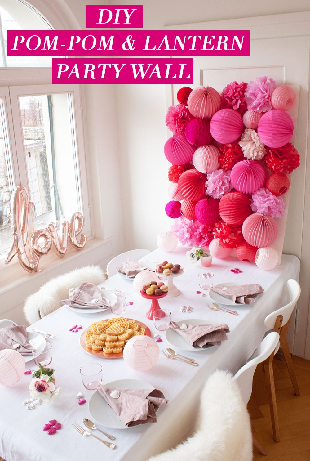 DIY Party Wall | Pom-Poms and Paper Lanterns make quite the statement wall!