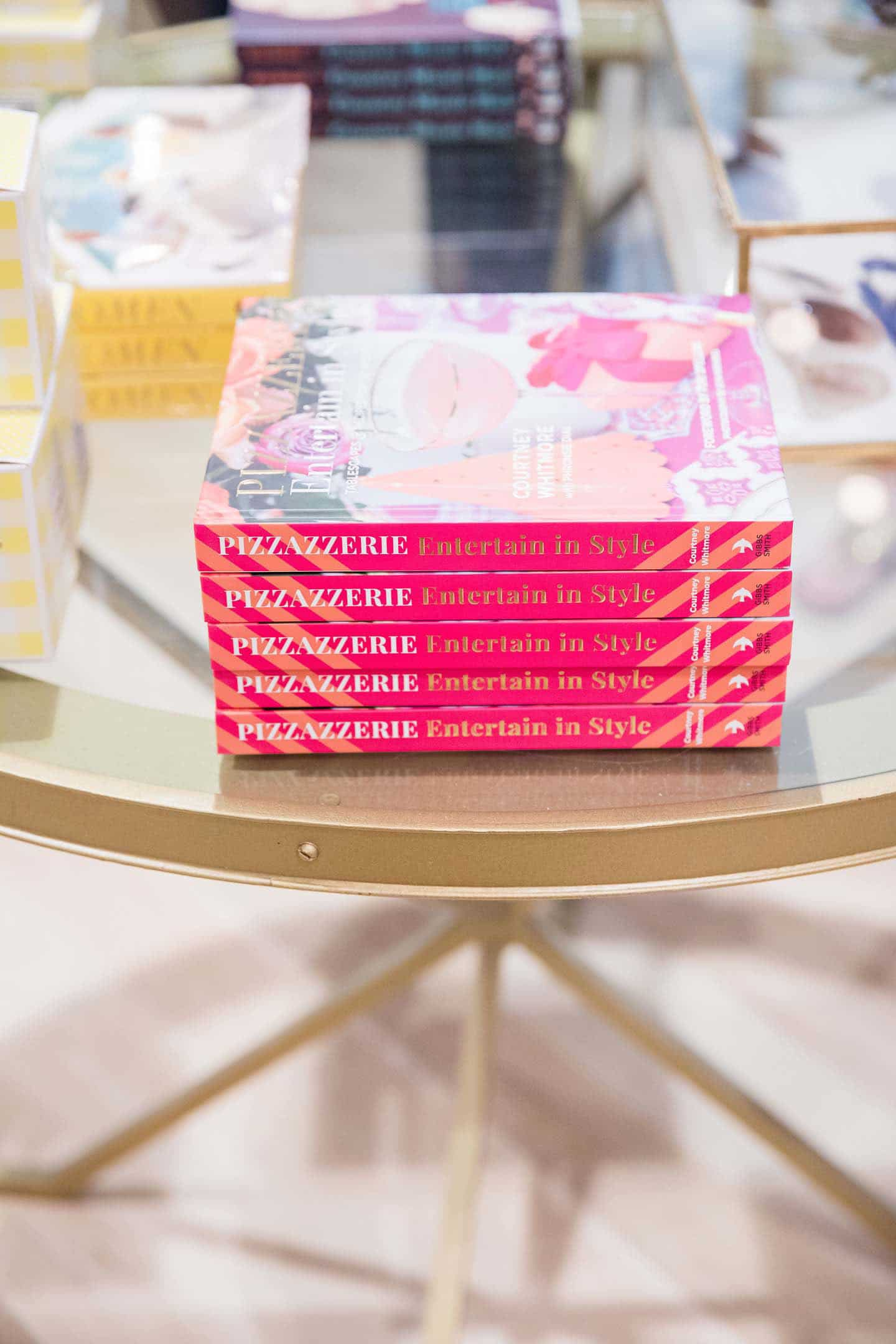 stack of pizzazzerie books at a store
