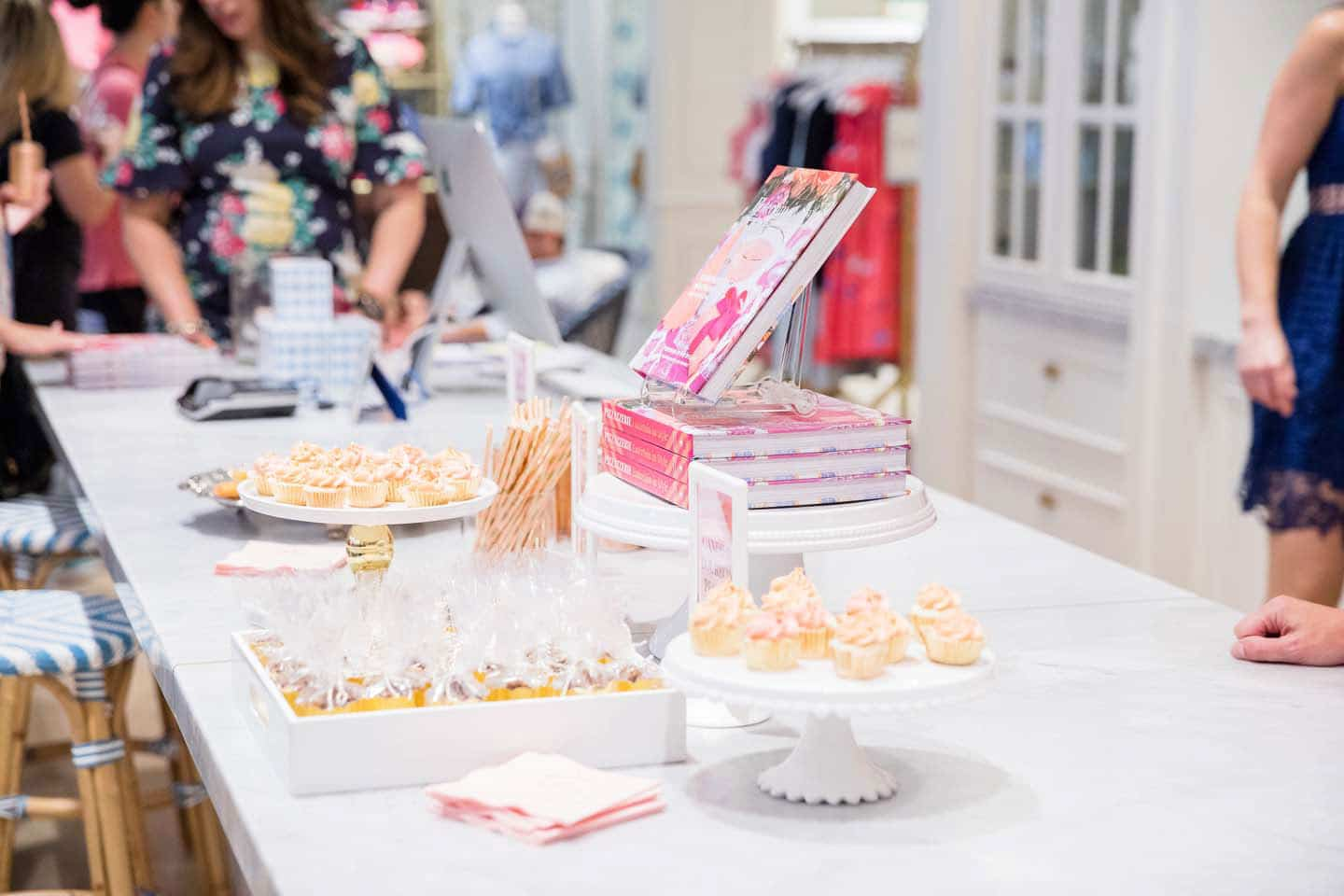 a party table with mini cupcakes at a book signing
