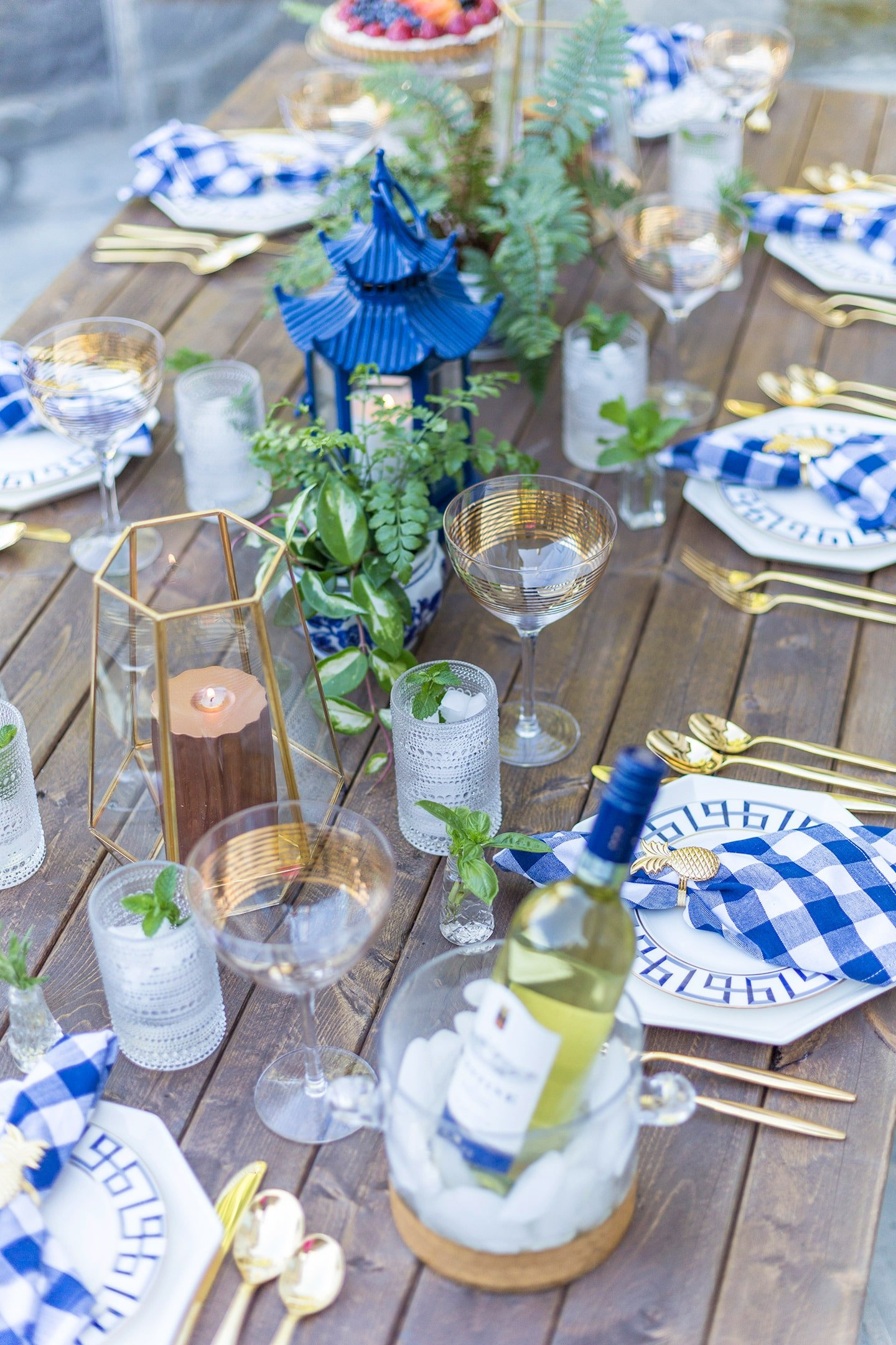 dinner party tablescape on a farm table