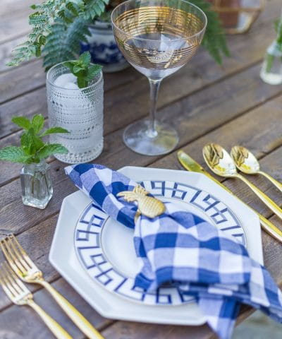bue and white dinner party tablescape place setting