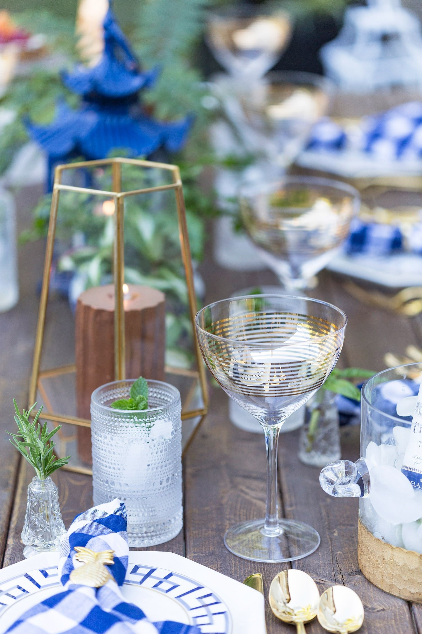 blue, white, and gold dinner party tablescape