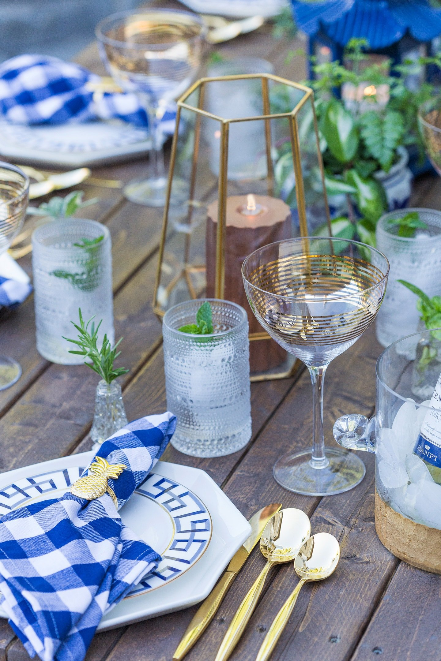 dinner party tablescape in blue and gold