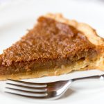 A piece of brown sugar pie on a plate
