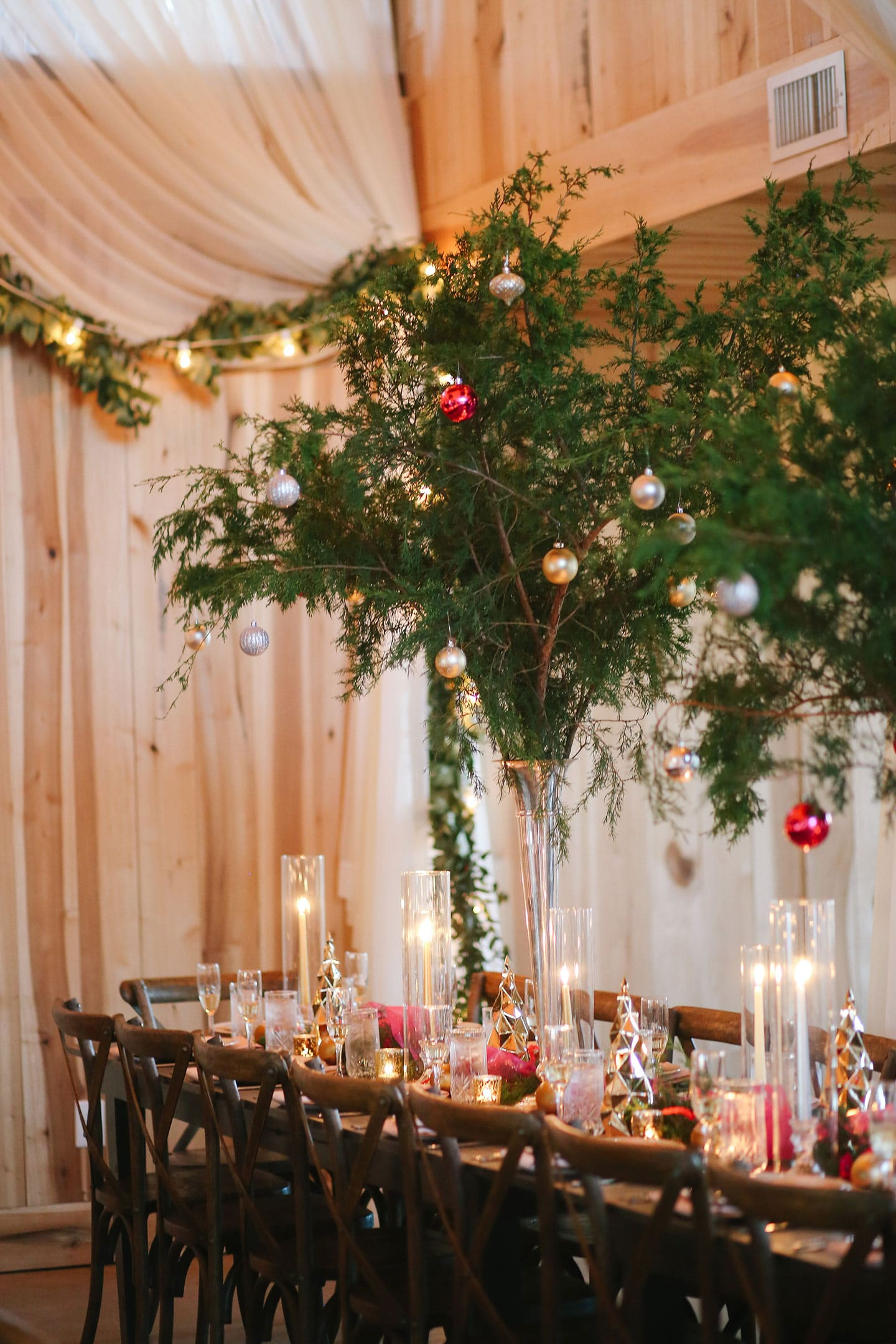 A dining table with a christmas tree