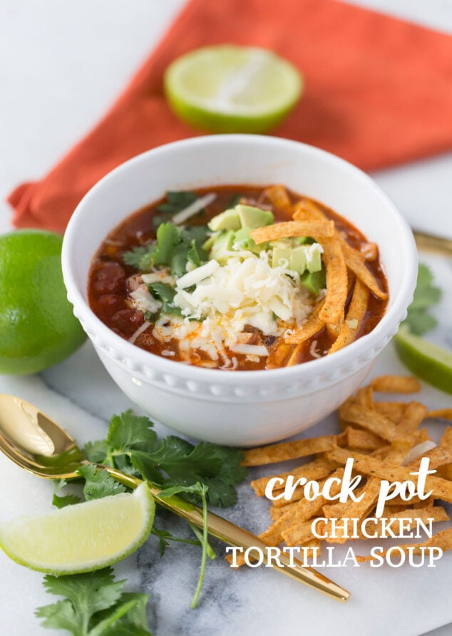 chicken tortilla soup in a white bowl on a marble background.