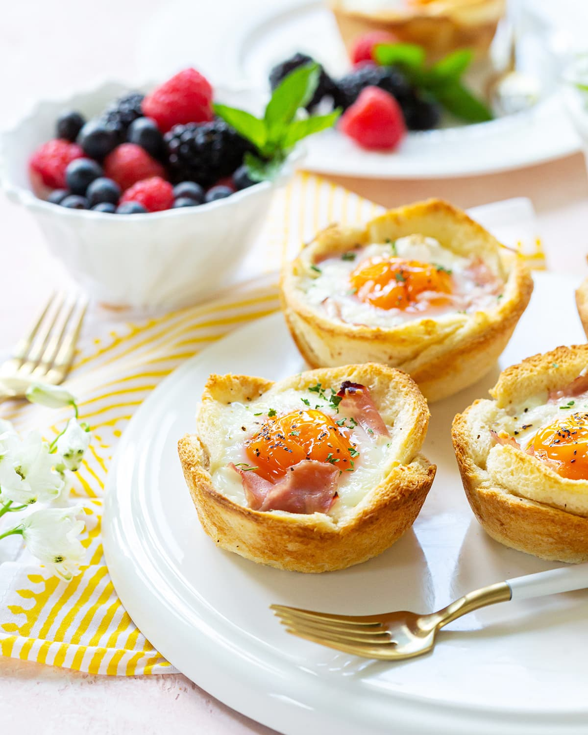 croque madame cups sitting on a white platter.