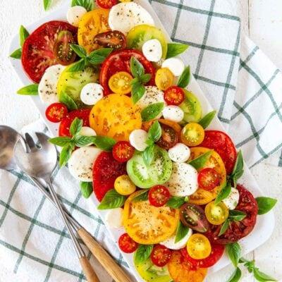 heirloom tomato caprese salad on a platter