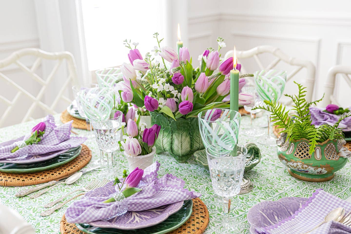 pretty spring table settings on purple and green table.