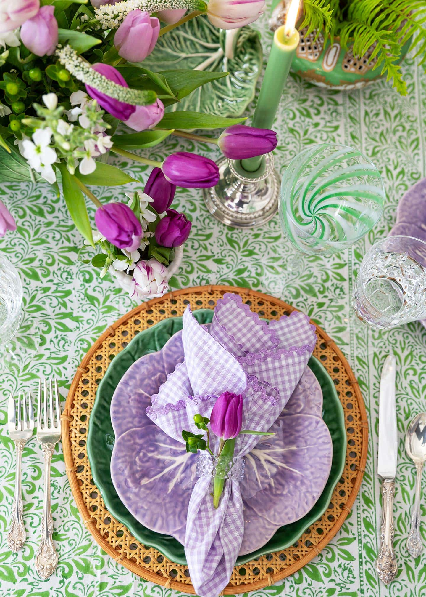 green cabbage leaf and purple flower place setting.