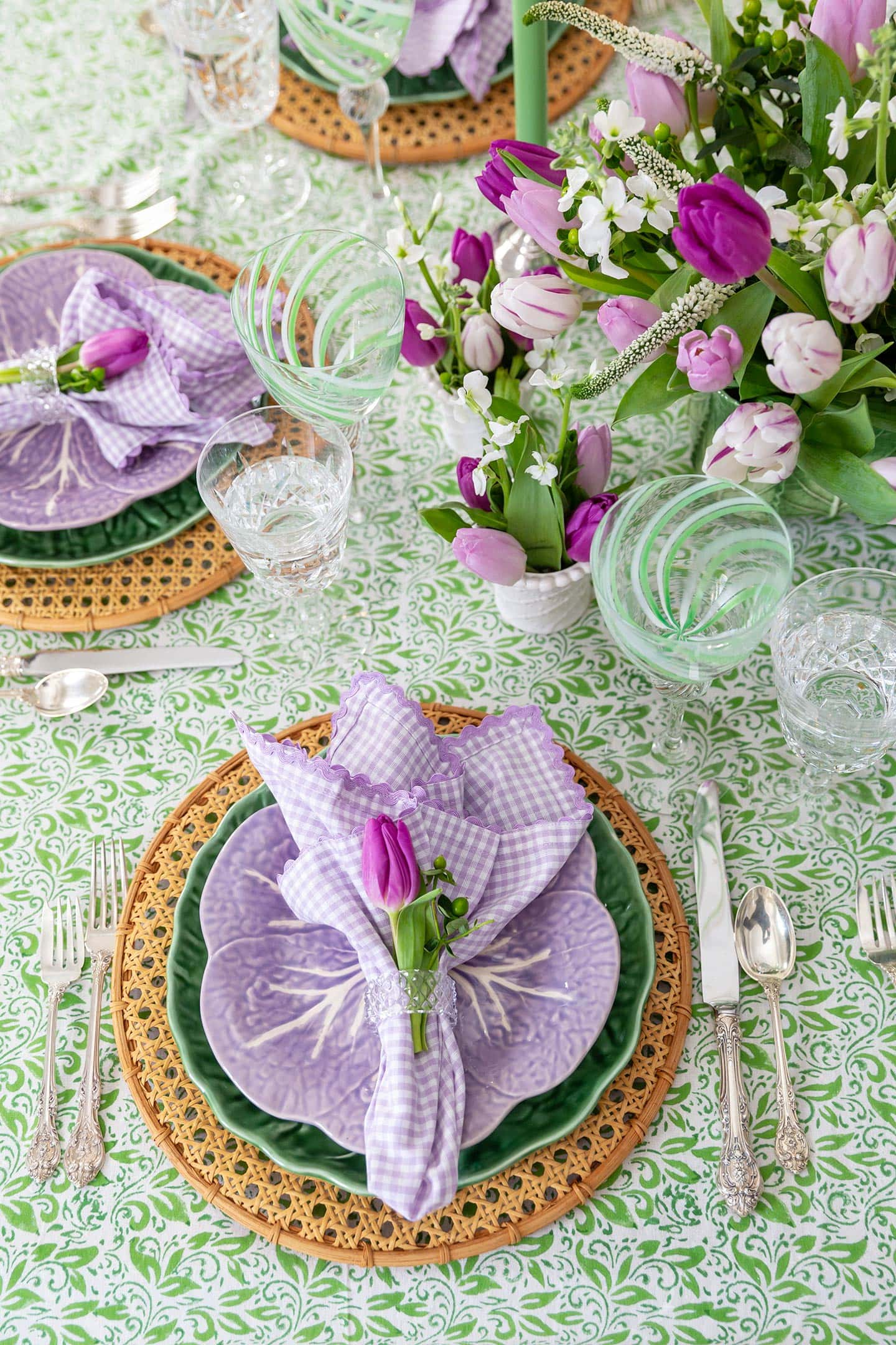 spring flower plates on table.
