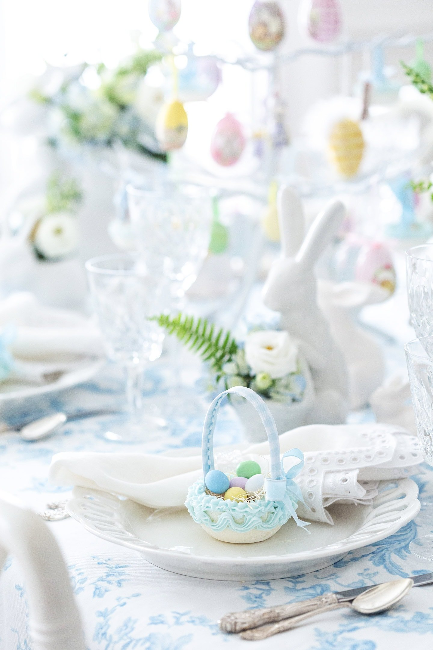 blue and white Easter place setting with sugar basket