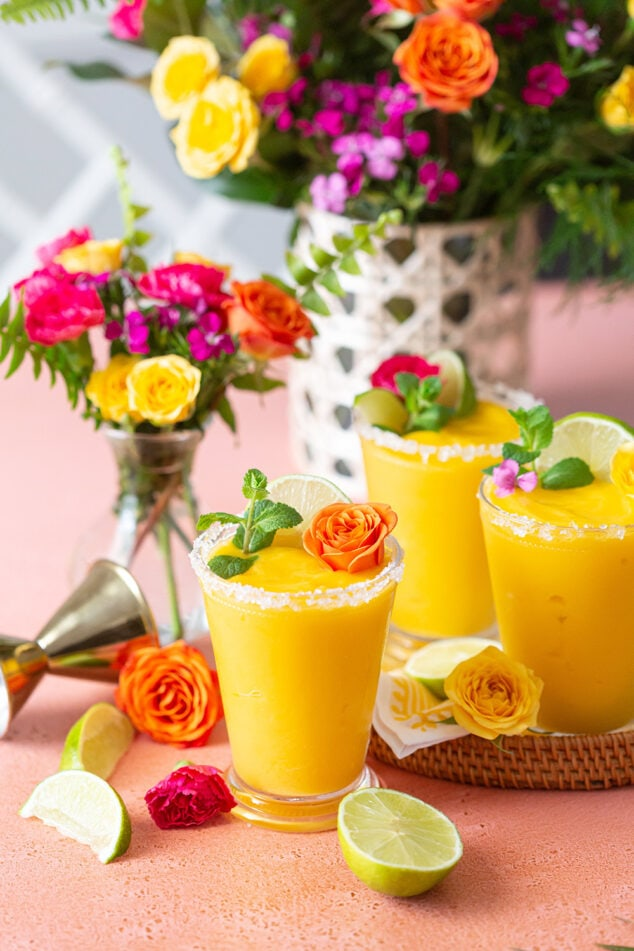 a tray of frozen mango margaritas with flowers