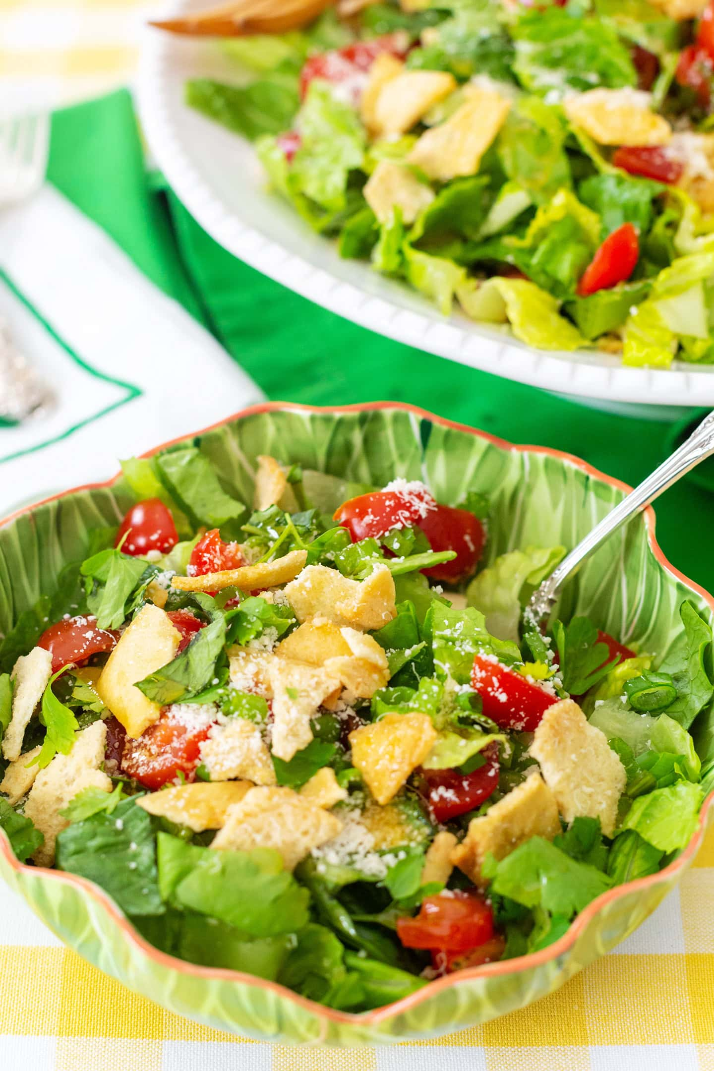 Green salad with pita chips, parmesan cheese and vinegar oil dressing.