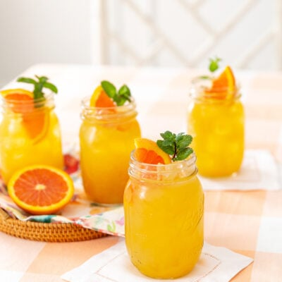 Fruit Tea garnished with orange slices and fresh mint sprigs