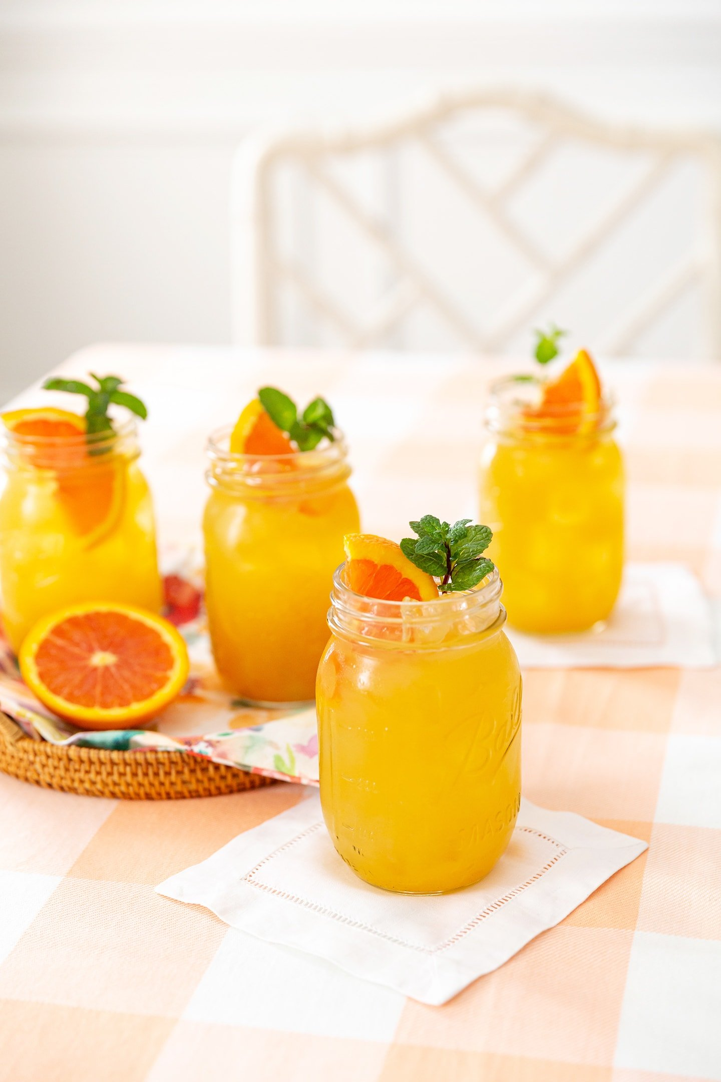 Fruit Tea garnished with orange slices and fresh mint sprigs